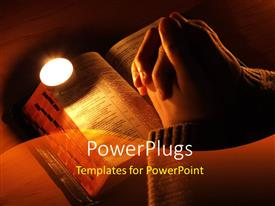 PowerPlugs: PowerPoint template with arms crossed in prayer on the Bible with the candle