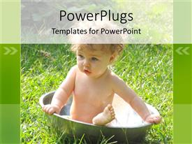 PowerPoint template displaying baby bathing in large stainless steel bowl outdoors on grass