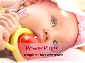 PowerPoint template displaying baby girl with pink bonnet chewing on rattle