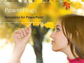 PowerPlugs: PowerPoint template with young beautiful girl inspects leaf of tree in autumn