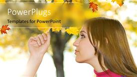 PowerPoint template displaying young beautiful girl inspects leaf of tree in autumn
