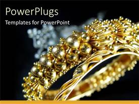 PowerPlugs: PowerPoint template with beautiful gold colored bracelet with majestic designs on it