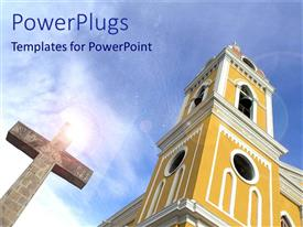 PowerPlugs: PowerPoint template with big catholic church with a cross under sun rays and a blue sky