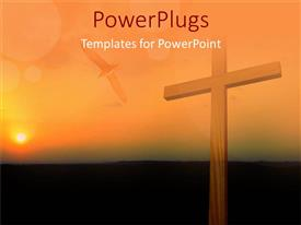 PowerPlugs: PowerPoint template with big wooden cross on a sun set landscape with a flying bird