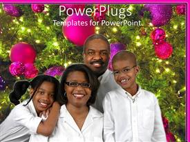PowerPlugs: PowerPoint template with black American family of four poses beside decorated Christmas tree