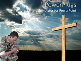 PowerPoint template displaying black army man crouching and praying in front of a large cross