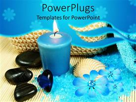 PowerPoint template displaying blue candle next to black pebbles and blue bath salts