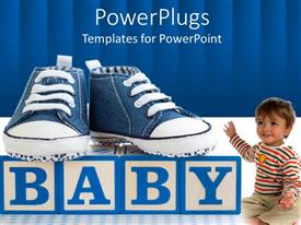 PowerPoint template displaying blue denim baby shoes on alphabet blocks