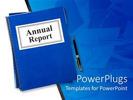 PowerPoint template displaying blue notebook tagged Annual report with pen on blue table
