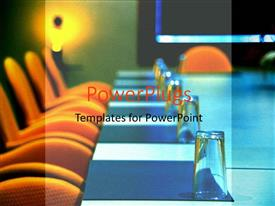 PowerPlugs: PowerPoint template with board room set up for a meeting with orange chairs, folders and glasses
