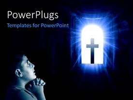 PowerPlugs: PowerPoint template with a boy with hands clasped, kneeling and praying with a cross