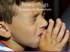 PowerPlugs: PowerPoint template with a boy praying with blackish background
