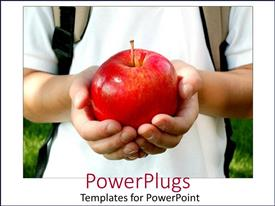 PowerPlugs: PowerPoint template with boy in white with a back pack holding a big red apple