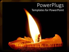 PowerPoint template displaying a burning candle just on the verge of being finished