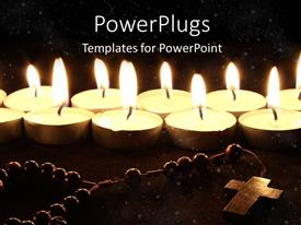 PowerPlugs: PowerPoint template with burning candles with crucifix on wooden desk at night