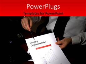 PowerPlugs: PowerPoint template with businessman in office holds document with company development plan in hand