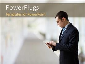 PowerPoint template displaying businessman operating touch screen PDA device over blurry background