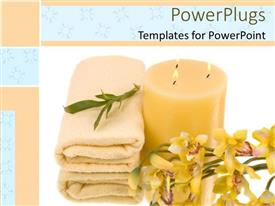 Audience pleasing theme featuring a candle with towels and flowers