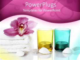 PowerPlugs: PowerPoint template with candles in yellow and blue glass cups with flower on white towel