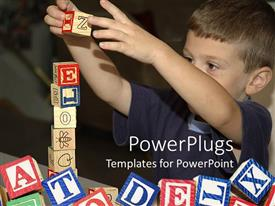 PowerPoint template displaying a child playing with various alphabetical blocks