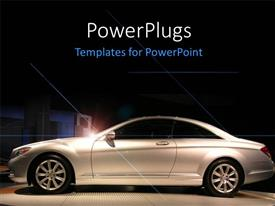 PowerPlugs: PowerPoint template with chrome plated two door luxurious car on exhibition with light glow