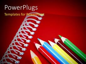 PowerPlugs: PowerPoint template with close-up depiction of pencils on a notebook with red color