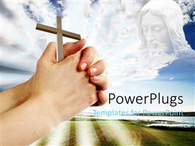 PowerPlugs: PowerPoint template with close of of hands holding wooden cross in religious themed background