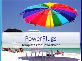 PowerPoint template displaying close up of lounge with colorful umbrella on the sandy beach and sea water with blue sky background