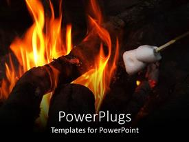 PowerPlugs: PowerPoint template with a close up view of a camp fire with flames and wood