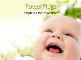 Amazing presentation theme consisting of close up view of a cute smiling baby on a blurry background