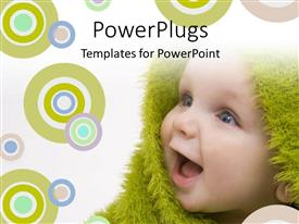 PowerPlugs: PowerPoint template with close up view of  a happy smiling baby wrapped with a green material