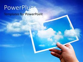 PowerPlugs: PowerPoint template with clouds rising up from a depiction with blue sky and lens flare