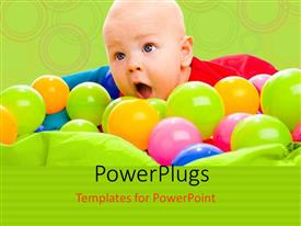 PowerPoint template displaying colorful balls surround happy baby boy in lying in basin