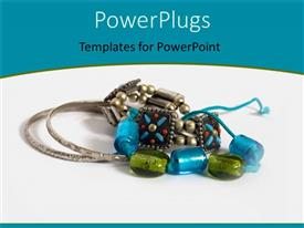 PowerPlugs: PowerPoint template with colorful jewelry with green and blue beads and silver rings on white background