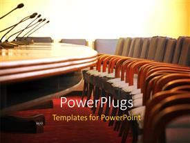 PowerPlugs: PowerPoint template with conference room with microphones and empty wooden chairs