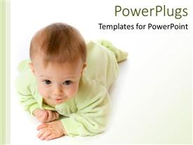 PowerPoint template displaying crawling baby wearing pale green pajamas on white background