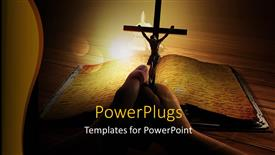 PowerPoint template displaying religious depiction with crucifix over old religious book on wooden table