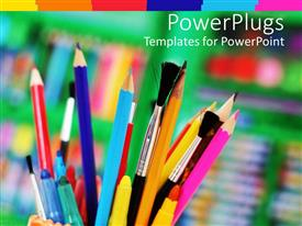 PowerPlugs: PowerPoint template with cup holding several paint brushes, pens, color pencils and markers