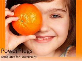 PowerPoint template displaying cute baby girl holding an orange in front of her one eye and smiling