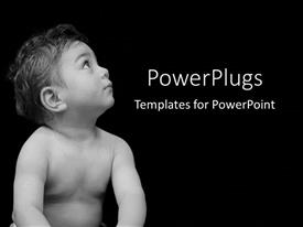 PowerPoint template displaying cute naked baby boy staring with a black background