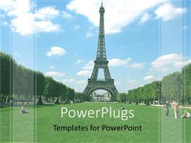 PowerPoint template displaying day time view of the Eiffel tower over looking a green field