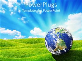 PowerPlugs: PowerPoint template with daylight depiction of the world or earth globe on green grass
