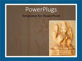PowerPoint template displaying dirty gold colored Indian statue carved to a wall