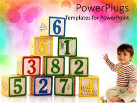 PowerPoint template displaying educational wooden blocks with colorful numbers and toddler boy showing the letters on rainbow colored background