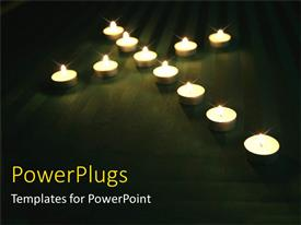 PowerPlugs: PowerPoint template with eleven candles making the shape of  crosss on a blak floor
