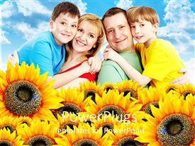 PowerPlugs: PowerPoint template with family of four smiling happily with lots of sunflowers