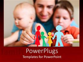 PowerPoint template displaying father and two sons holding a colorful Paper cut family figure