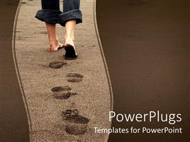 PowerPlugs: PowerPoint template with feet of a person leaving footprints on a beach on sandy background