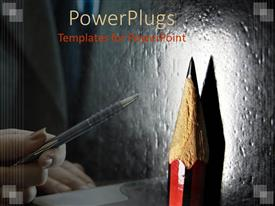 PowerPlugs: PowerPoint template with feminine hand holding pen pointing to close up of spotlighted pencil point