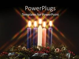 PowerPoint template displaying five lit multi colored candles on a black background